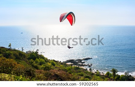 Para glider and  Beautiful Tropical beach Querim in sunset ,Goa, India - stock photo