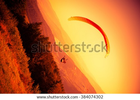 Para glider paragliding with his parachute at Zar Mountain in Poland - stock photo