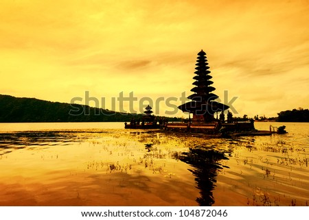 Para Ulun Danu Temple also known as Lake Bratan Temple. The temple located in Bedugul in the central highlands of Bali. The Temple is devoted to the goddess of the lake Ida Betara Dewi Ulun Danu. - stock photo