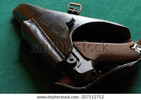 Parabellum pistol in leather holster - stock photo