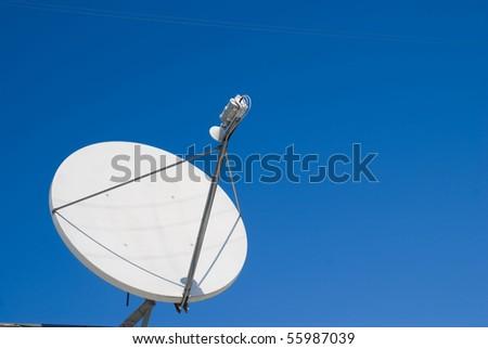 parabolic antenna large white against the blue sky - stock photo
