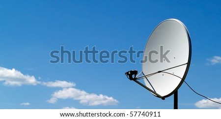parabolic antenna on a background of blue sky - stock photo