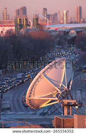 Parabolic satellite dish space technology receivers over the city, Toronto, Canada - stock photo