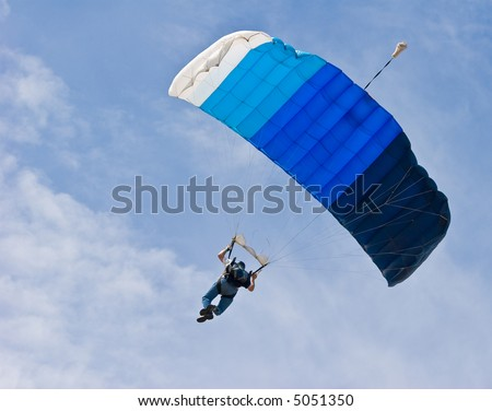 parachutist floating on the breeze - stock photo