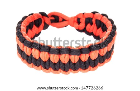 Paracord survival Bracelet using a Blaze weave in Blaze orange or hunter orange and black cord, the teams colors of the San Francisco Giants - stock photo