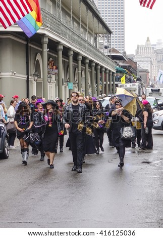 Parade of Street musicians in New Orleans French Quarter - NEW ORLEANS, LOUISIANA - APRIL 18, 2016  - stock photo
