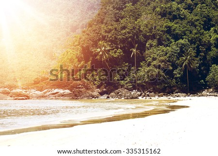Paradise banner beach background. Coconut palms and ocean at sunset. Vintage (retro) effect. White sand beach and sunshine. - stock photo