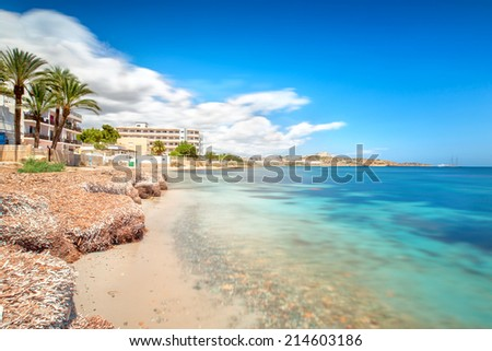 Paradise beach in Ibiza island with blue sky and crystal water