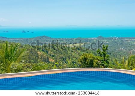 Paradise Farm Park swimming pool at Samui Thailand and panoramic view of island - stock photo