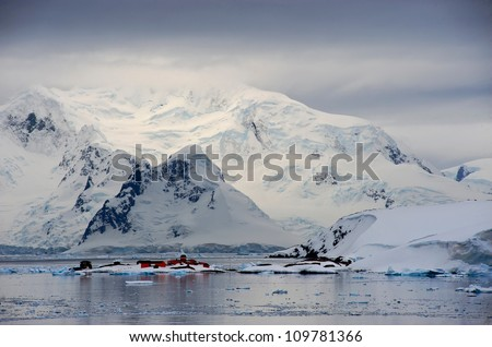 Paradise Harbour (Bay) on the Western coast of the Antarctic Peninsular home to two research bases and one of the few place visited by cruise ships in Antarctic waters - stock photo