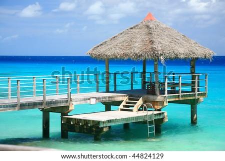 paradise island pontoon on blue lagoon - stock photo