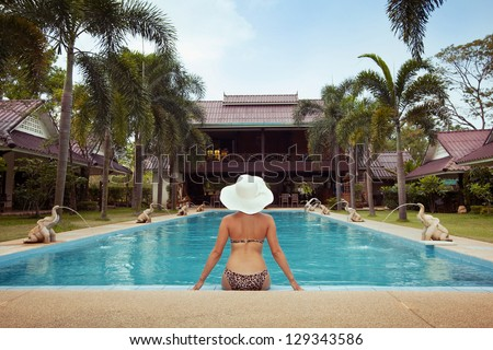 paradise place, woman near the swimming pool - stock photo