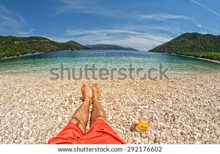 Paradise Relax with pint of beer at Antisamos Beach in Kefalonia, Greece - stock photo