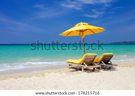 Paradise vacation on a tropical island/Sunbeds in a tropical beach/Thailand, Trat - stock photo