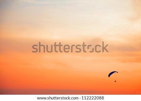 Paraglider - Feeling free on the sunset sky