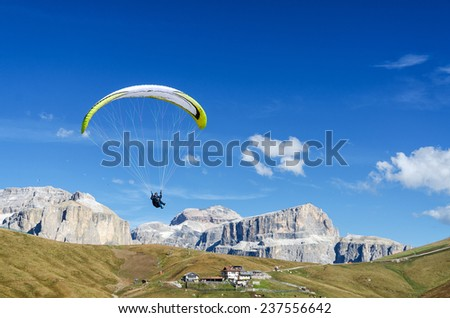 Paraglider in front of Sella mountains, South Tyrol, Italy - stock photo