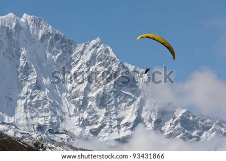 Paraglider near peak Lhotse (8516 m) - Chhukhung, Nepal, Himalaya - stock photo