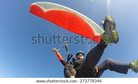 Paraglider tandem from below - stock photo