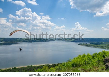 paraglider to fly over the river Bakota - stock photo