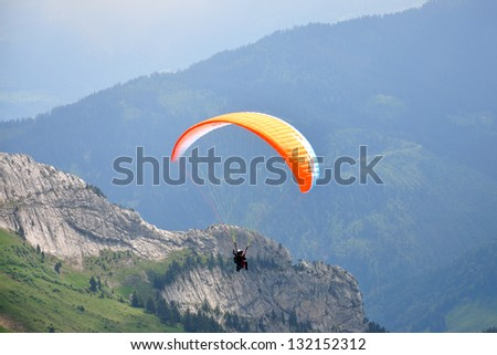 Paraglider with the instructor at Pilatus mountain near Lucern, Switzerland,