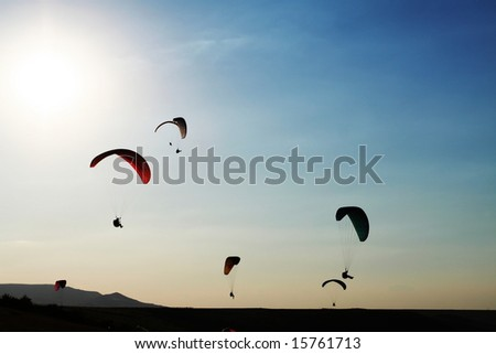 Paragliders - stock photo