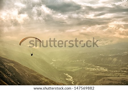 Paragliding in Andes at the sunset - stock photo