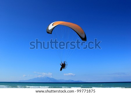 Paragliding in Greece against clear blue sky