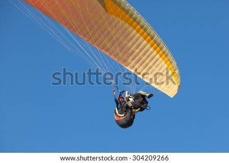 paragliding in the mediterranean sky - stock photo