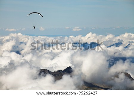Paragliding over the Swiss Alps - stock photo