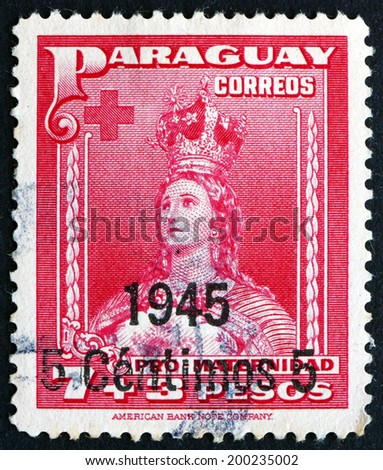 PARAGUAY - CIRCA 1945: a stamp printed in Paraguay shows Our Lady of Asuncion, circa 1945 - stock photo
