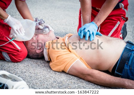 Paramedics succor a man with heart attack - Stock Image - stock photo