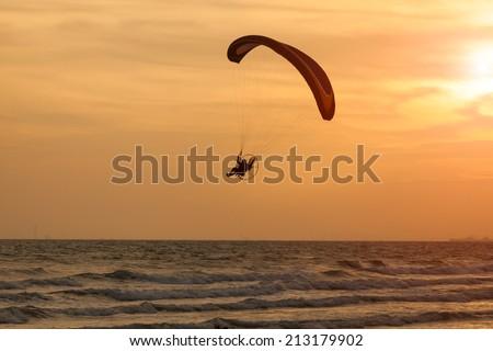 Paramotor flight over sea - stock photo