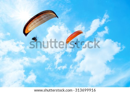 Paramotor flying in the sky - stock photo