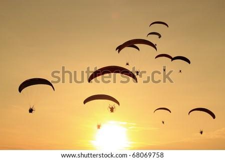 paramotor in sunset - stock photo