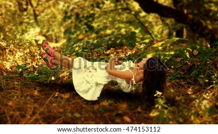 stock-photo-paranormal-activity-girl-floating-in-the-forest-and-enjoy-the-summer-day-474153112.jpg