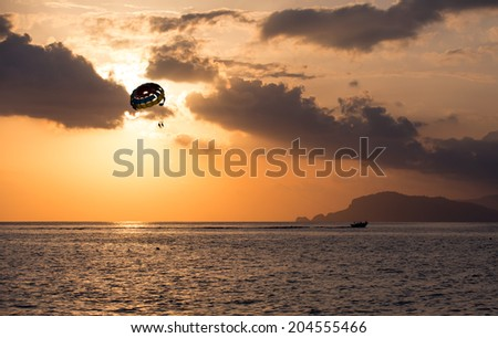 Parasailing at sunset, Alanya beach - stock photo