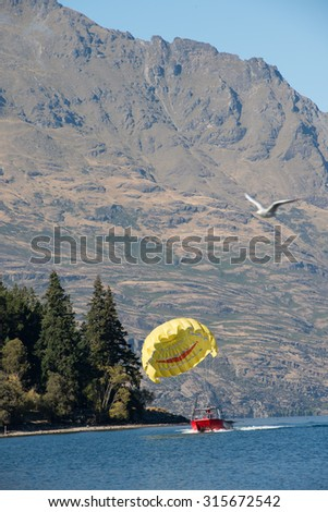 Parasailing in the Bay of Islands, sailing and tourist destinations in New Zealand. - stock photo