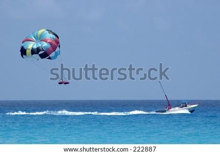 Parasailing over the Caribbean Sea, Cancun. - stock photo