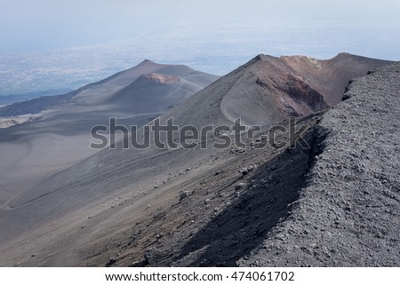 Parasite craters from the trail to the Etna crater, shot from almost the top of the volcano in Italy. Desert consisting from ash all olver the side of the volcano