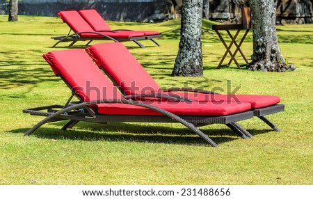 parasol and sunbed - stock photo