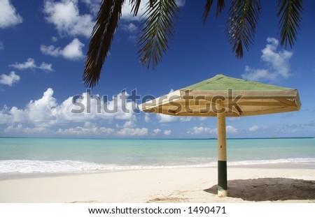 Parasol at a caribbean beach - stock photo