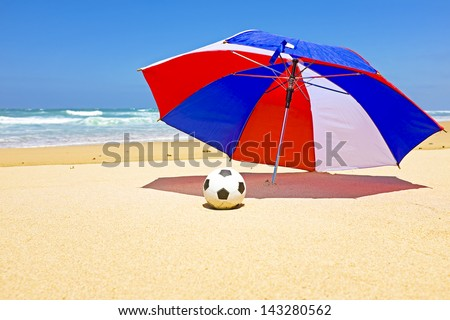 Parasol with ball at the beach