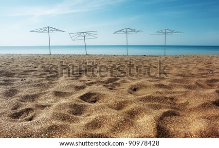 Parasols on the sandy beach - stock photo