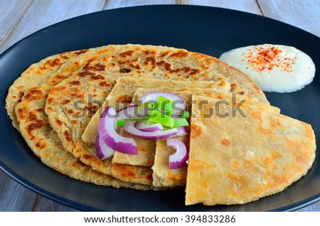 Paratha flatbread Indian cuisine. Food background and texture - stock photo