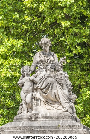 Parc de Bruxelles (or Warandepark) - the largest public park in the center of Brussels, Belgium. Sculpture at entrance. Warandepark is surrounded by the Royal Palace of Brussels. - stock photo