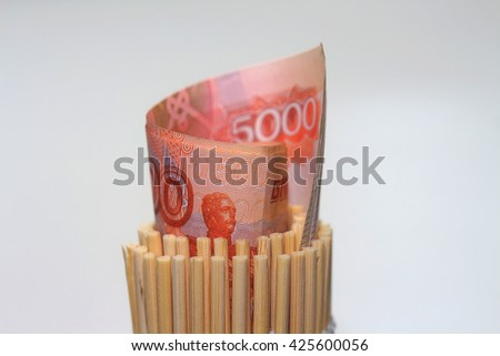 parcel of banknotes of the Russian rubles in a bamboo mat - stock photo