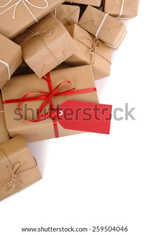 Parcel : pile brown package, red gift tag isolated, vertical - stock photo