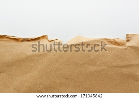Parcel torn paper background - stock photo
