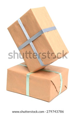 Parcel wrapped with recyclable brown paper - stock photo