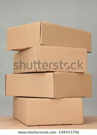 Parcels boxes on wooden table, on grey background